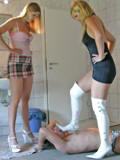 Goddesses humilate a slave in a bathroom