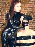 Mistress Lillith torments the taped down slave's nipples