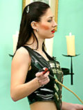 Madame Sarka trains slaves in the vestibule
