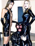 Two women in leather & boots dominate a man
