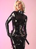 Susan Wayland in tight latex and boots