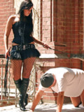 Girls trampling slaves in black boots