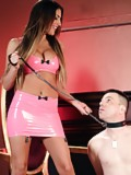 Mistress August Aimes with a chastised slave on her leash