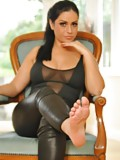 Wet look legging foot tease
