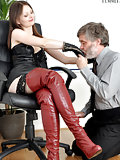 Older man serves girl in red thigh boots
